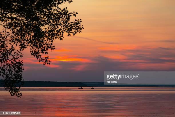 sunset above dnieper river - kiew stock-fotos und bilder