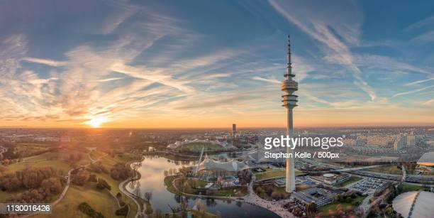 sunset above olympiapark, munich , germany - オリンピック公園 ストックフォトと画像