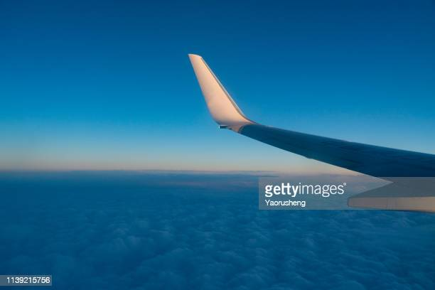 sunset above the cloud,flying in the sunset over sky - aircraft wing stock pictures, royalty-free photos & images