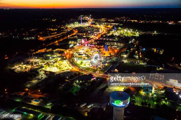 sunset aerial view of hwy 76 in branson missouri - 1011957648,1011945618,1011950492,1011960800,1011954950,1011953954,1015768380,1015768366,1015768370,1015768372,1015768382,1015768398,1015768412,1015768410,1015768414,1015768418,1015768438,1015768448,1015768450,1015768488,1015768474,1015768478,1015768504,1015768508,1016083590,1016083634,1016083592,1016083608,1016083686,1016083708,1016083780,1016083774,1016083796,1016083828,1016083994,1016083992,1016083982,1016083980 stock pictures, royalty-free photos & images