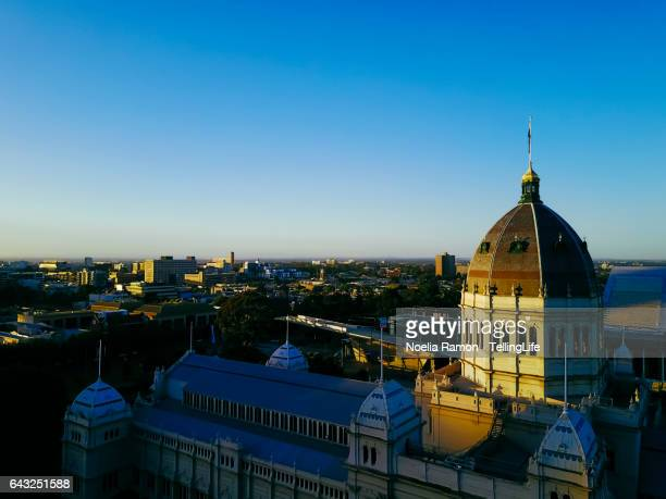 sunset aerial view of north melbourne and the exhibition centre, carlton gardens, victoria - carlton gardens stock pictures, royalty-free photos & images