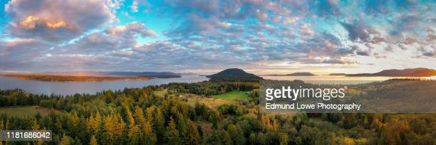 sunset aerial view of rural lummi island, washington. - puget sound stock pictures, royalty-free photos & images