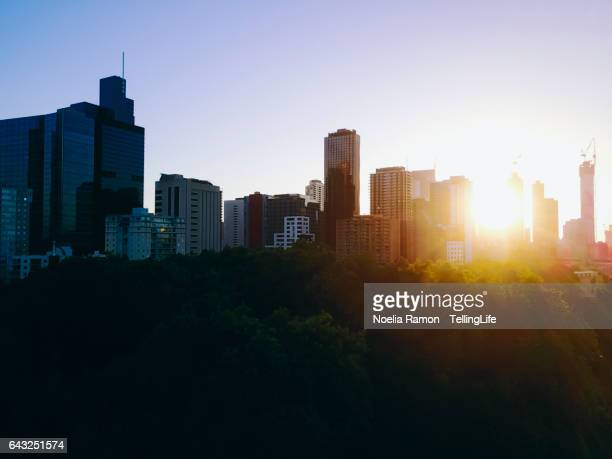 Sunset Aerial view of the skyline of Melbourne and Carlton Gardens, Victoria