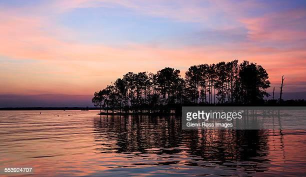 sunset afterglow on lake murray south carolina - columbia south carolina stock pictures, royalty-free photos & images