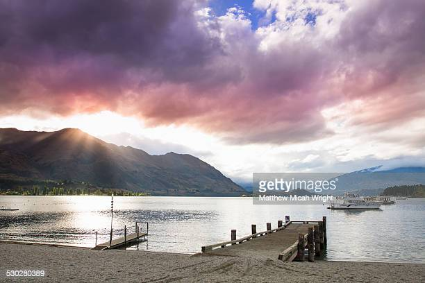 a sunset along the shores of lake wanaka - jetty stock pictures, royalty-free photos & images