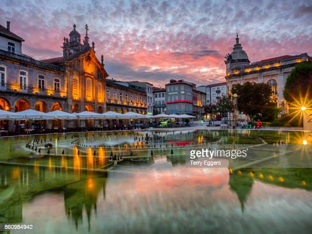 Sunset along the sidewalk of cafe and town square at dusk, Praca da Republica