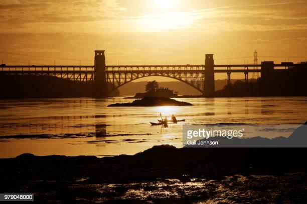 sunset and brittania bridge from church island menai bridge isle anglesey north wales - menai bridge stock photos and pictures