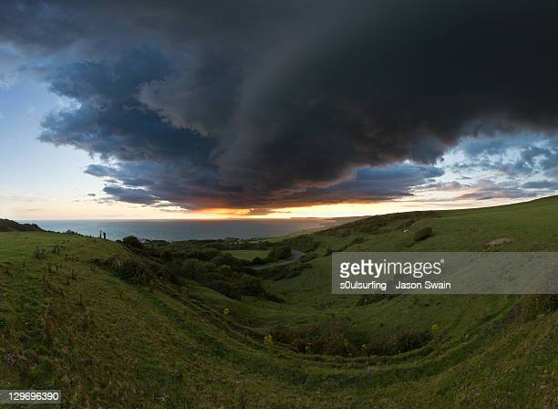sunset and clouds over hills - s0ulsurfing stock pictures, royalty-free photos & images