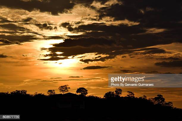 sunset and clouds - silhueta stock photos and pictures