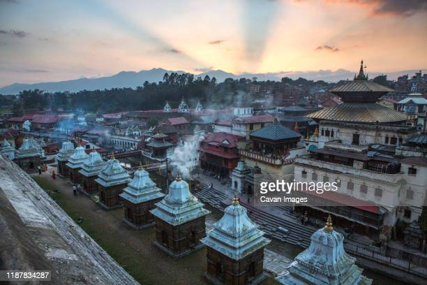 sunset and cremations at pashupatinath temple in kathmandu, nepal. - pashupatinath stock pictures, royalty-free photos & images