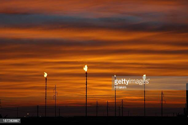 sunset and gas flaring - kazakhstan stock pictures, royalty-free photos & images