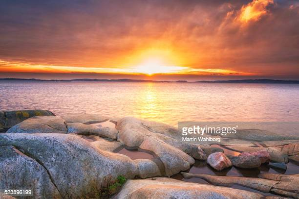 Sunset and granite rocks and boulders shaped by Ice sheet