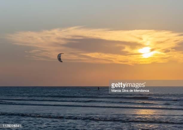 Sunset and kitesurfing practice at Jericoacoara beach.