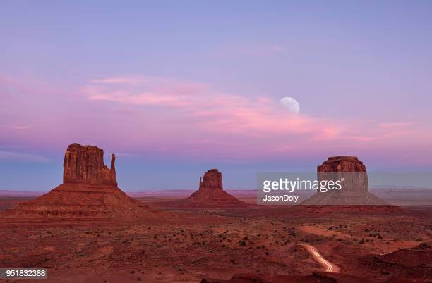 sunset and moon rise at monument valley - arizona stock pictures, royalty-free photos & images