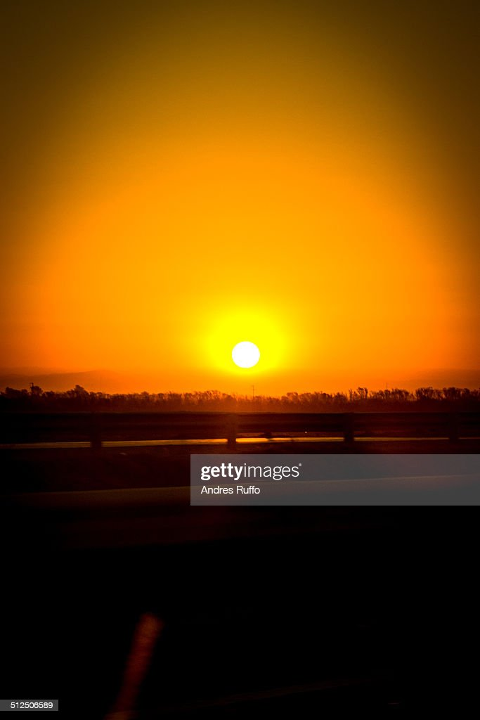 Sunset and mountain views from the road : Stock Photo
