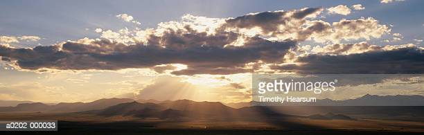 sunset and mountains - timothy hearsum stock pictures, royalty-free photos & images