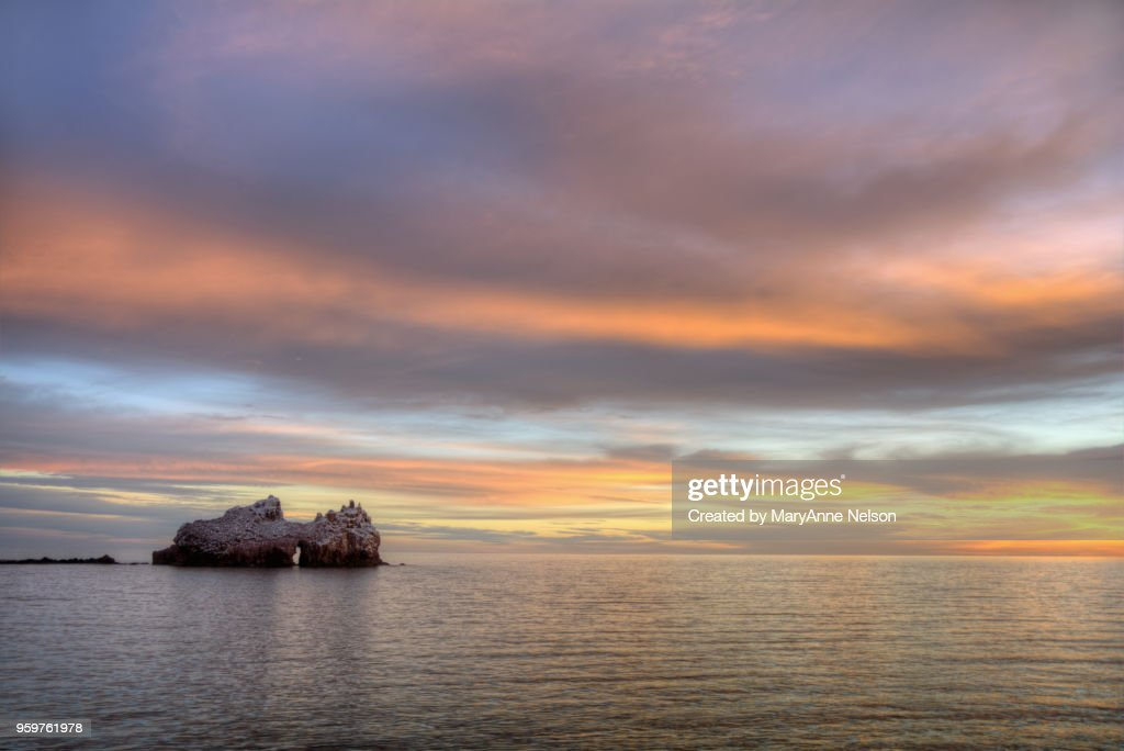 Sunset and Part of Seal Rocks in Sea of Cortes : Stock-Foto
