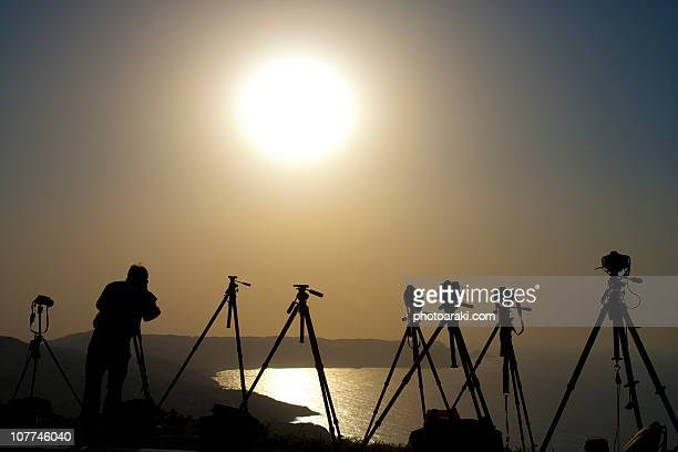 sunset and photographer - 三脚 ストックフォトと画像