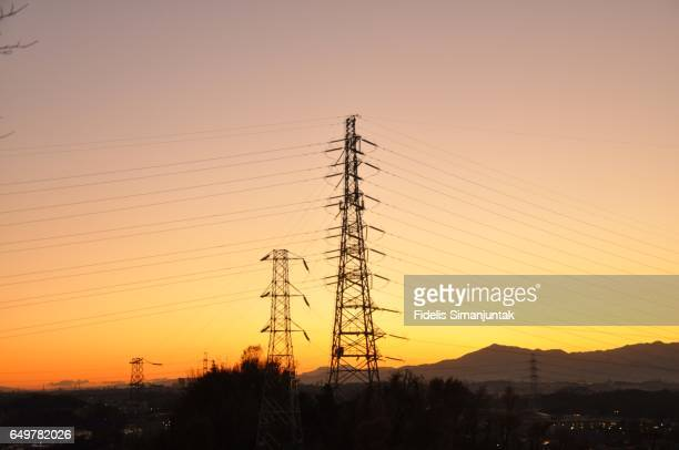 Sunset and power cable at Tokyo suburb area