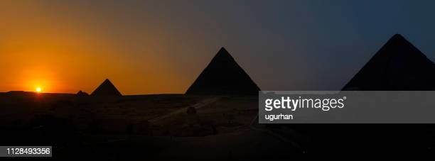 sunset and pyramids in giza, cairo - pyramid shape stock pictures, royalty-free photos & images