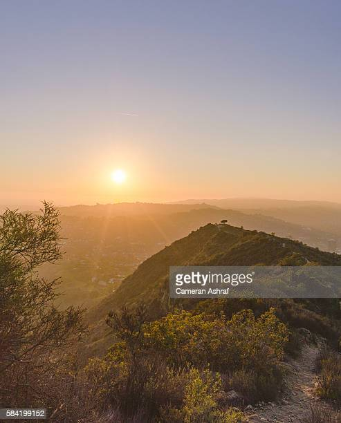 sunset and scenic view of west los angeles from hiking in the hollywood hills - los angeles mountains stock pictures, royalty-free photos & images