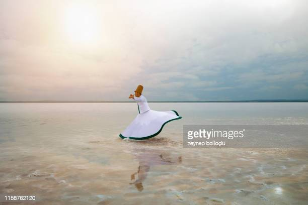 sunset and whirling at the sea, sufi. sufi whirling (turkish: semazen) is a form of sama or physically active meditation which originated among sufis. - ottoman empire stock pictures, royalty-free photos & images