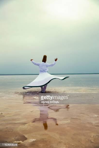 sunset and whirling at the sea, sufi. sufi whirling (turkish: semazen) is a form of sama or physically active meditation which originated among sufis. - ceremony stock pictures, royalty-free photos & images
