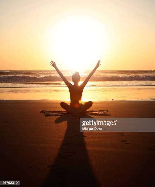 sunset arms raised yoga pose - spiritual enlightenment stock pictures, royalty-free photos & images