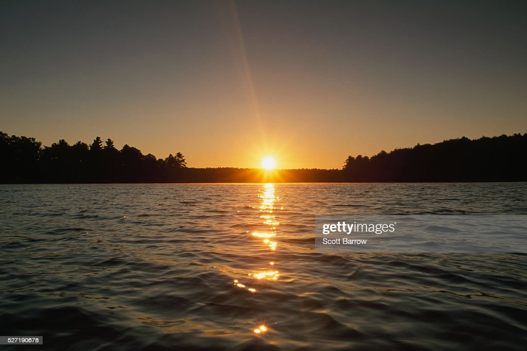 Sunset at a lake : Stock Photo