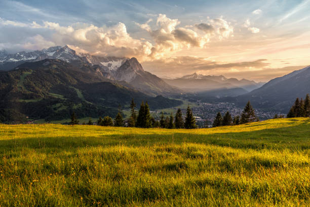 sunset at a mountain pasture over garmisch-partenkirchen - germany stock pictures, royalty-free photos & images