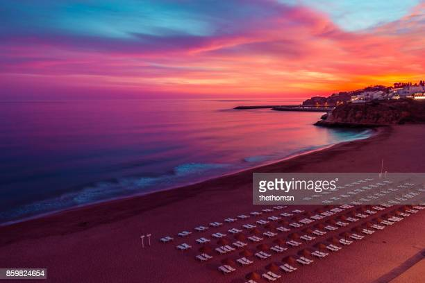 sunset at albufeira, portugal - albufeira stock pictures, royalty-free photos & images