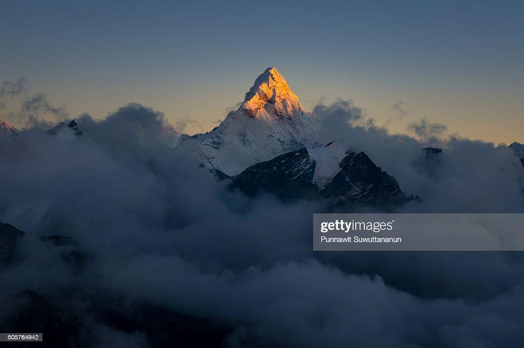 Sunset at Ama Dablam mountain peak : Stock Photo