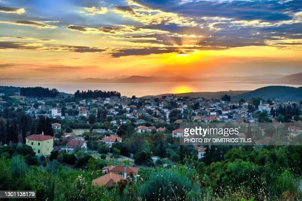 sunset at argalasti - dimitrios tilis stock pictures, royalty-free photos & images