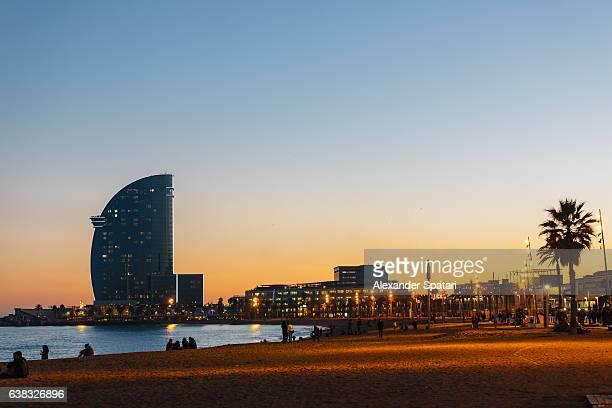 sunset at barceloneta beach, barcelona, spain - la barceloneta stock pictures, royalty-free photos & images