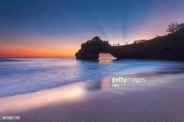 sunset at batu bolong & tanah lot - bali, indonesia - image title stock pictures, royalty-free photos & images