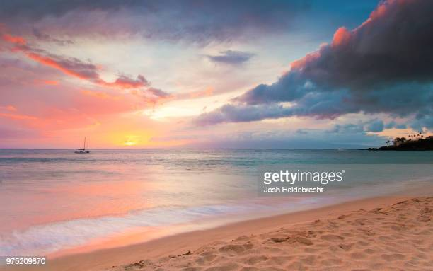 sunset at beach with boat in distance, kaanapali, maui, hawaii, usa - sunset stock pictures, royalty-free photos & images