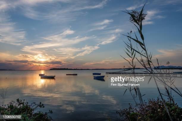 sunset at birgi vecci at lo stagnone sicilly - finn bjurvoll stock-fotos und bilder
