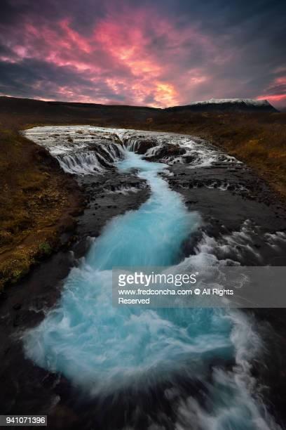 Sunset at Brúarfoss waterfall in Iceland