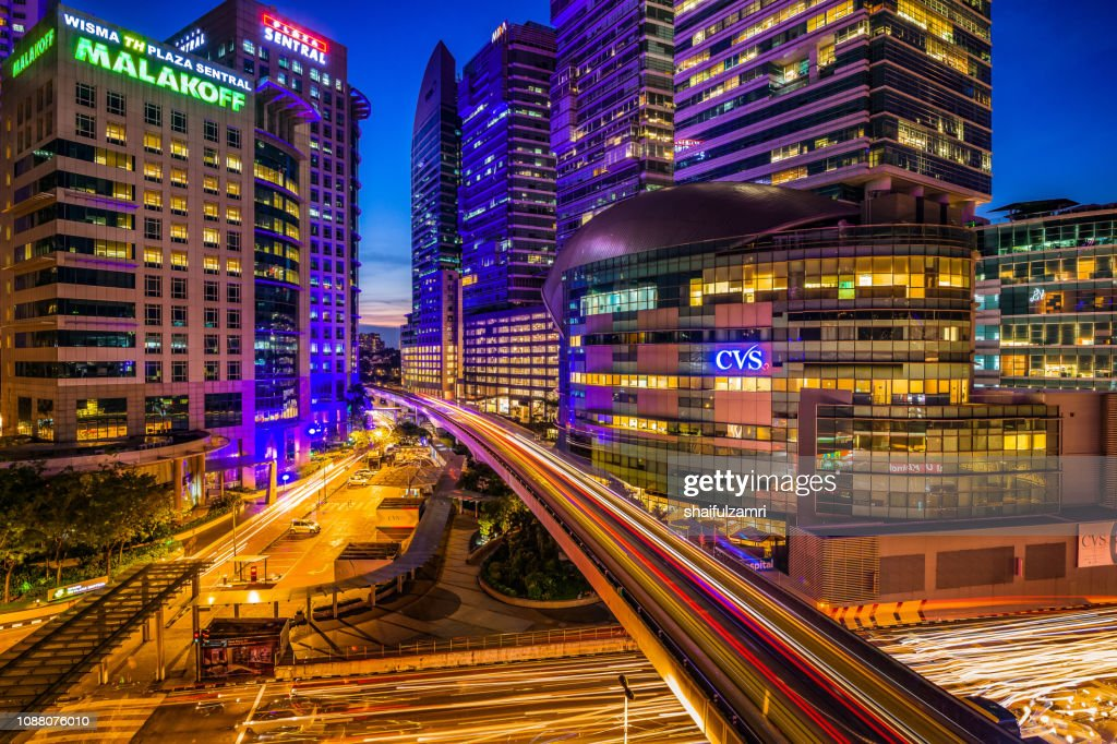 Sunset at busy junction in downtown Kuala Lumpur near train station. : Stock Photo