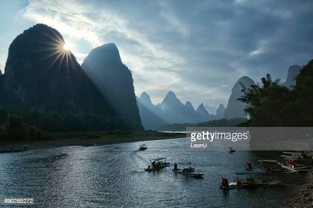Sunset at busy Li River, Guilin, China