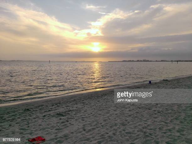 sunset at cape coral yacht club beach - post-production stock pictures, royalty-free photos & images