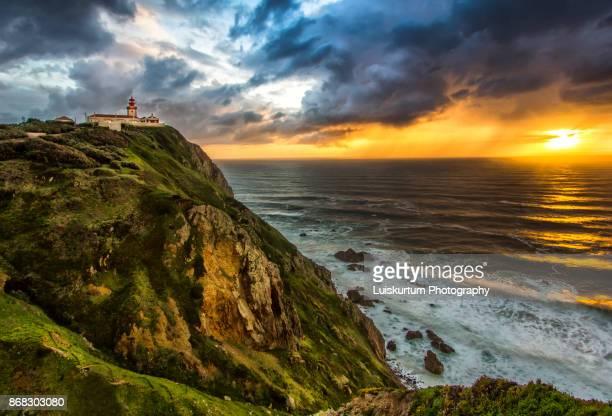 sunset at cape roca - faro city portugal fotografías e imágenes de stock