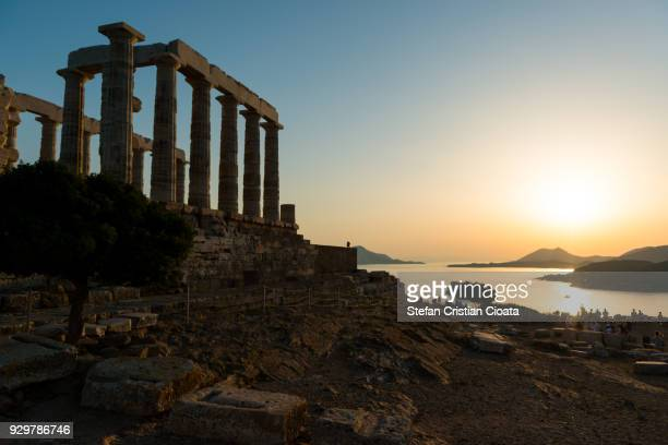 sunset at cape sounio, greece - old ruin stock photos and pictures