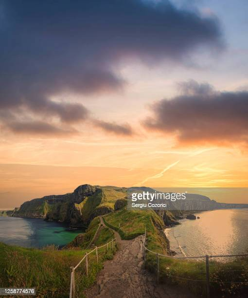 sunset at carrick-a-rede rope bridge - belfast stock pictures, royalty-free photos & images
