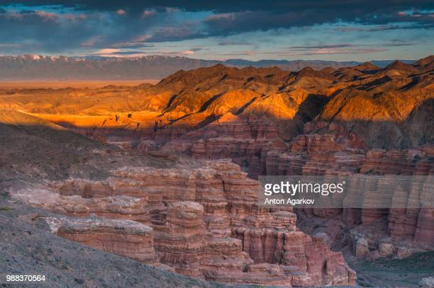 sunset at chary canyon in kazakhstan. - kazakhstan stock pictures, royalty-free photos & images