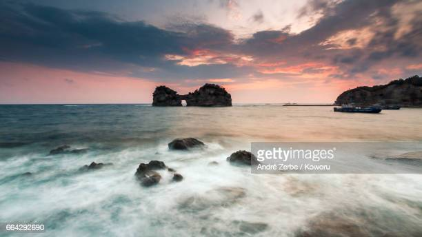 sunset at coast, coastline in front ot engetsu-to in shirahama, japan on a summer day - sonnig stock pictures, royalty-free photos & images