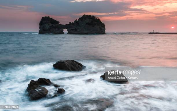 sunset at coast, coastline in front ot engetsu-to in shirahama, japan on a summer day - sonnenuntergang stock pictures, royalty-free photos & images