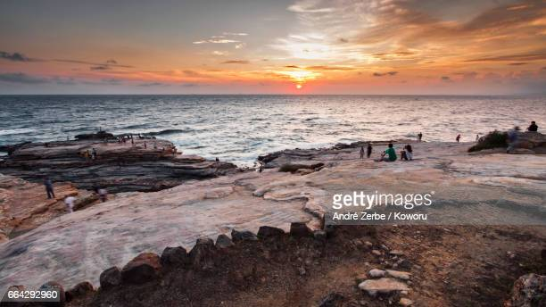 sunset at coast, coastline shirahama, japan on a summer day - menschengruppe stock pictures, royalty-free photos & images