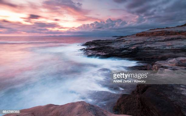 sunset at coast, coastline shirahama, japan on a summer day - landschaft stock pictures, royalty-free photos & images