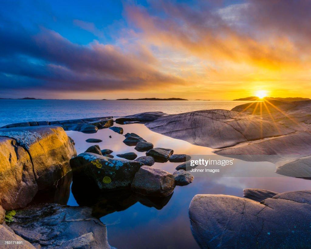 Sunset at coast : Stock Photo